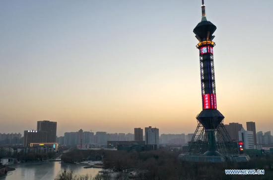 Shijiazhuang Television Tower illuminated to honor city's fight against COVID-19